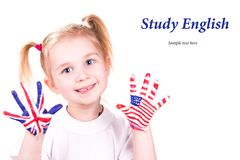 American and English flags on child's hands. Learning English language concept Stock Photos