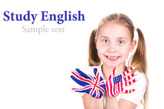 American and English flags on child's hands. Royalty Free Stock Photography