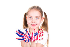 American and English flags on child's hands. Stock Photo