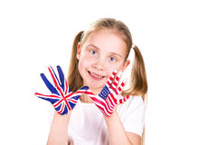American and English flags on child's hands. Stock Image