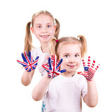 American and English flags on child's hands. Learning English language concept Royalty Free Stock Photo
