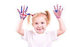 American and English flags on child's hands. Learning English language concept Stock Image