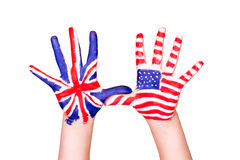 American and English flags on hands. Learning English language concept Royalty Free Stock Image