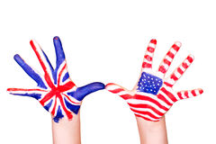 American and English flags on hands. Learning English language concept Royalty Free Stock Photos