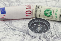 American and European currencies with compass Royalty Free Stock Photos