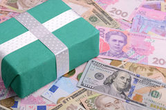 American and european money background and green gift box Royalty Free Stock Images