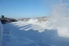 American Falls in the winter. Niagara River completely frozen, plus view of the American Falls and the Rainbow Bridge, in the winter,  27 February 2015, on a Stock Image