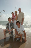 American Family. A family portrait. An american family on the shore of a beach with seagulls behind them royalty free stock images