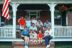 American family. On front porch Royalty Free Stock Photo