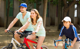 American family cycling in park Royalty Free Stock Photos