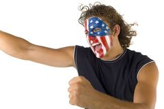 The American fan. Young screaming fan with painted The USA flag on face. He's on white background Royalty Free Stock Photos