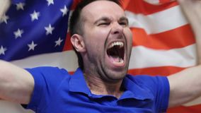 American Fan Celebrating while holding the flag of America. The American Fan Celebrating while holding the flag of America, high quality stock footage