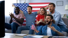American fans celebrating goal, watching match on TV at home, proud of country royalty free stock photo