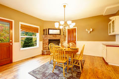 American farm house breakfast dining room area with brick fireplace. Stock Photo