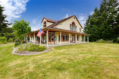 American farm house exterior with large land Royalty Free Stock Images
