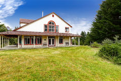 American farm house exterior with red trim Stock Image