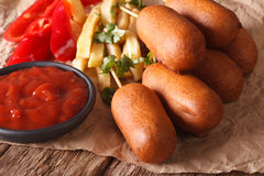 American fast food: Corn dogs, french fries and ketchup close-up Royalty Free Stock Images