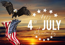 American feast 4th of July. Bald Eagle with American flag. American feast 4th of July, Independence Day. North American Bald Eagle flying with American flag Royalty Free Stock Photography