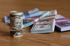 American Fifty Dollar Bills rolled up with a thread on the backg Royalty Free Stock Images