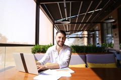 American financier working with laptop and diagram documents at Royalty Free Stock Images