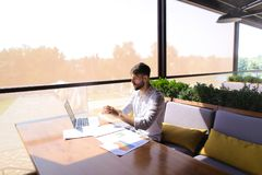 American financier working with laptop and diagram documents at Royalty Free Stock Photo