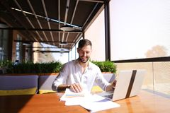 American financier working with laptop and diagram documents at Royalty Free Stock Photography