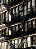 American fire escapes on an old building at Chicago Center - Sepia Glow Artistic Effect Stock Photo