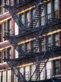 American fire escapes on an old building at Chicago Center - Soft Sunset Artistic Effect Stock Images