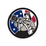 American Fireman USA Flag Icon. Icon retro style illustration of an American firefighter or fireman holding a fire hose front view with United States of America Stock Photos
