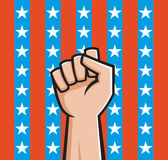American Fist. Vector Illustration of a raised fist front of American stars and stripes Stock Photo