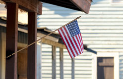 American Flag 0n Porch Royalty Free Stock Images