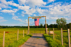American flag. On the gate of farm stock images