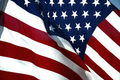American flag. Closeup of Stars and Stripes American flag blowing in wind stock photography