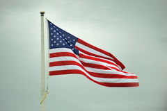 American Flag. Flying at full staff waving in the wind Royalty Free Stock Image
