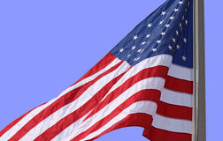 American Flag. Flying high against a brilliant blue sky royalty free stock photography