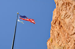 American flag. Stars and stripes unfurling by the cliff Stock Photo