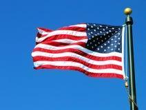 American Flag. Against a blue sky stock photography