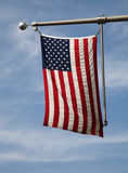 American Flag. Hanging from the side of a building Royalty Free Stock Photos