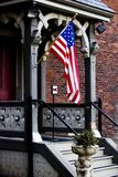 American Flag. On the porch of  an old victorian mansion Royalty Free Stock Image