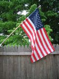 American flag. On fence Stock Photography