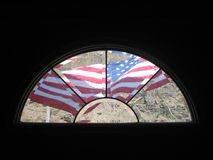 American flag. Outside a window Royalty Free Stock Images