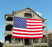 American Flag. Large size American flag hanging on a front of a house Royalty Free Stock Photo