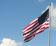 American flag. Blowing in the wind on a pole Royalty Free Stock Images