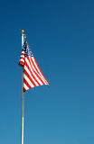American Flag. Flying from a pole underneath the summer sky Royalty Free Stock Photography