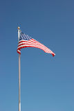American Flag. Flying from a pole underneath the summer sky Royalty Free Stock Photos