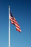 American Flag. Flying from a pole underneath the summer sky Stock Photos