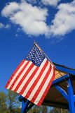 American Flag. Over blue sky on a sunny day Royalty Free Stock Image