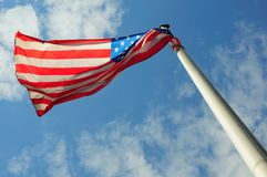 American Flag. In the blue sky royalty free stock photos