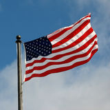 American Flag. Against a blue sky Stock Photos