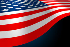 American flag. Flowing on a blue back ground Royalty Free Stock Photo